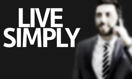 pursue: Business man with the text Live Simply in a concept image