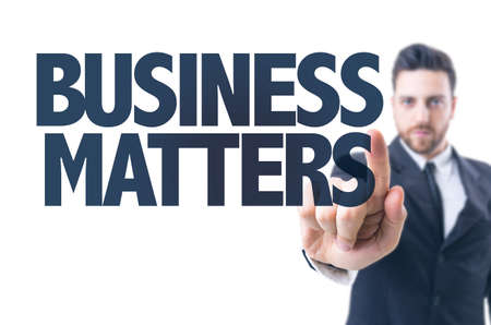 matters: Business man pointing the text: Business Matters Stock Photo