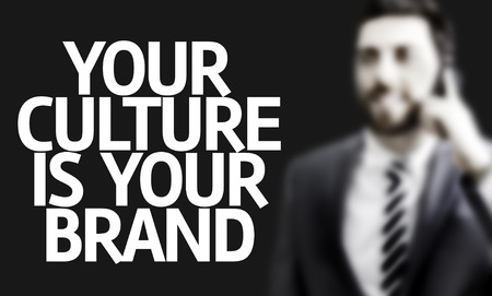 identidad cultural: Business man with the text Your Culture Is Your Brand in a concept image