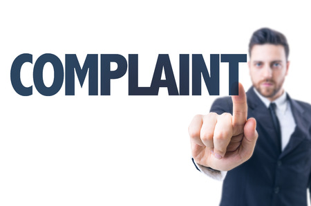 complaint: Business man pointing the text: Complaint Stock Photo