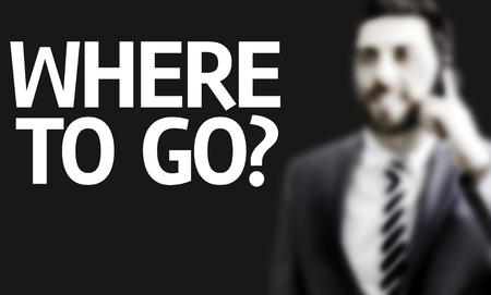 indecisive: Business man with the text Where to Go? in a concept image Stock Photo