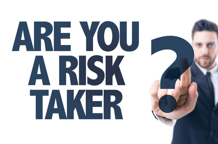 taker: Business man pointing the text: Are You a Risk Taker?