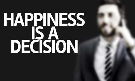 acknowledgment: Business man with the text Happiness Is a Decision in a concept image