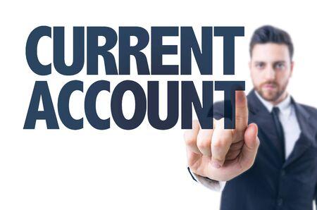 L'homme d'affaires pointant le texte: Compte courant Banque d'images