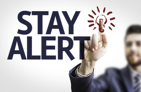 stay alert: Business man pointing the text: Stay Alert Stock Photo