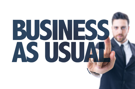 Business man pointing the text: Business As Usual Stock Photo