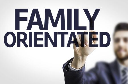 orientated: Business man pointing the text: Family Orientated Stock Photo