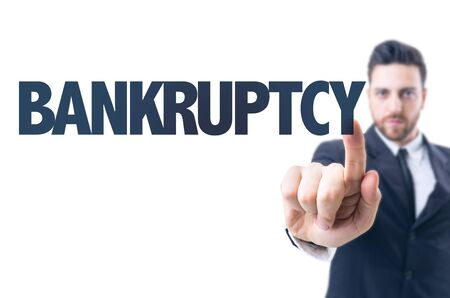 creditors: Business man pointing the text: Bankruptcy Stock Photo
