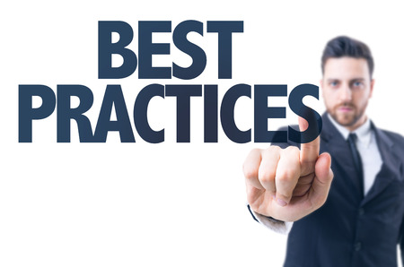 best practices: Business man pointing the text: Best Practices