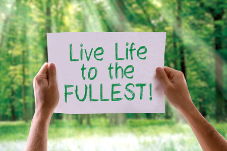 contentment: Hands holding Live Life to the Fullest text on nature background Stock Photo
