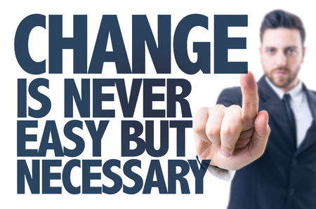 career job: Business man pointing the text: Change Is Never Easy But Necessary