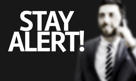 stay alert: Business man with the text Stay Alert in a concept image Stock Photo