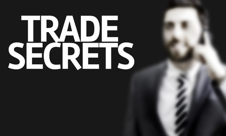 privileged: Business man with the text Trade Secrets in a concept image Stock Photo