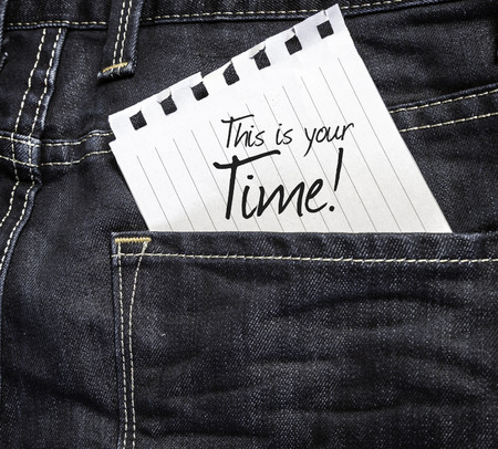 This Is Your Time written on a piece of paper on a jeans background Zdjęcie Seryjne