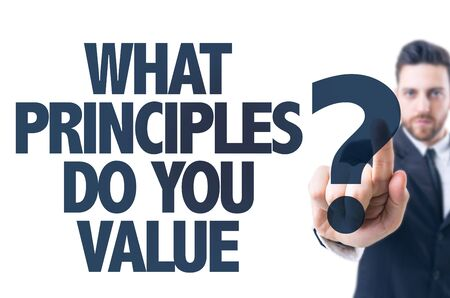 ethics and morals: Business man pointing the text: What Principles Do You Value?