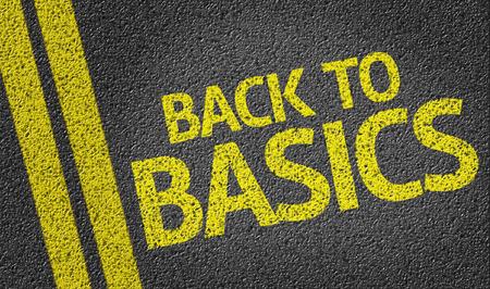 Back to Basics geschreven op de weg Stockfoto - 57868025