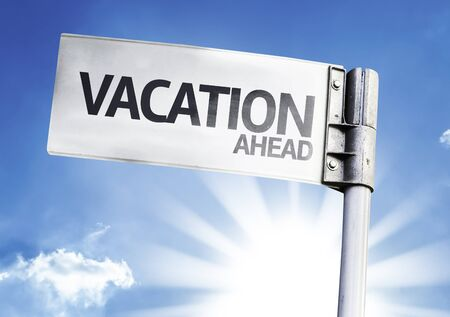 anticipate: Vacation Ahead sign with clouds and sky background Stock Photo