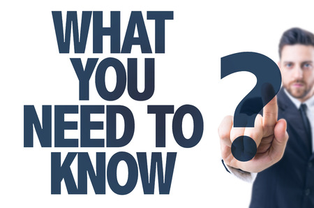 Business man pointing the text: What You Need to Know? Stock Photo