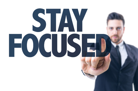 objectivism: Business man pointing the text: Stay Focused Stock Photo