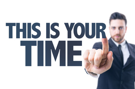 eminence: Business man pointing the text: This is Your Time Stock Photo