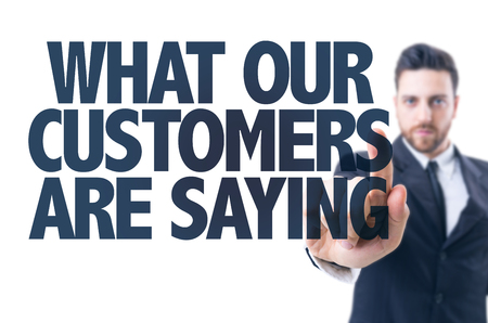 customer relationship: Business man pointing the text: What Our Customers Saying? Stock Photo