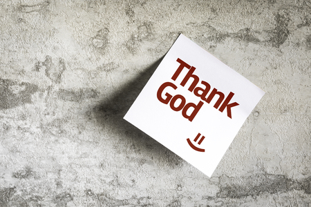 thankfulness: Thank God written on paper note on texture background Stock Photo