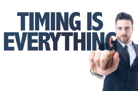 Business man pointing the text: Timing is Everything Stock Photo
