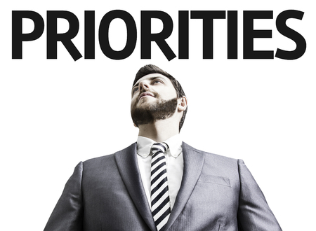 priorities: Business man with the text Priorities in a concept image