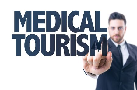health care fees: Business man pointing the text: Medical Tourism Stock Photo