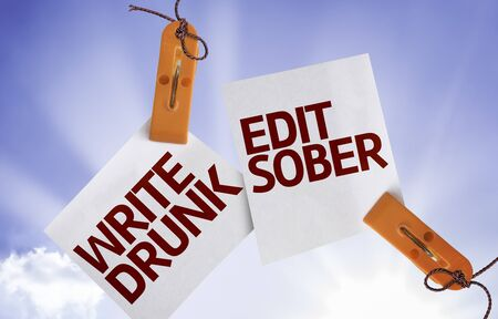 sober: Write Drunk Edit Sober written on paper note with clips on sky background