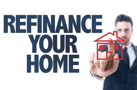 refinance: Business man pointing the text: Refinance Your Home