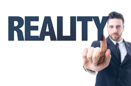 realism: Business man pointing the text: Reality