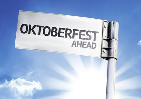 beerfest: Octoberfest Ahead on sign with clouds and sky background Stock Photo
