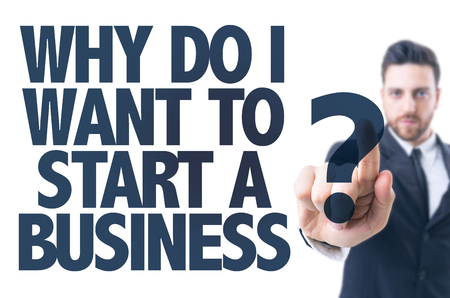 why: Business man pointing the text: Why Do I Want to Start a Business? Stock Photo