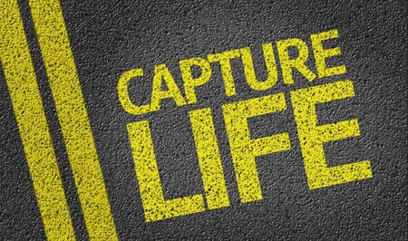 capture: Capture Life written on the road