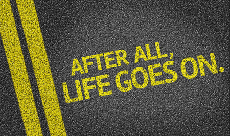 goes: After all, life goes on written on the road Stock Photo
