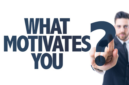 motivation: Business man pointing the text What Motivates You?