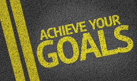 achieve: Achieve Your Goals written on the road