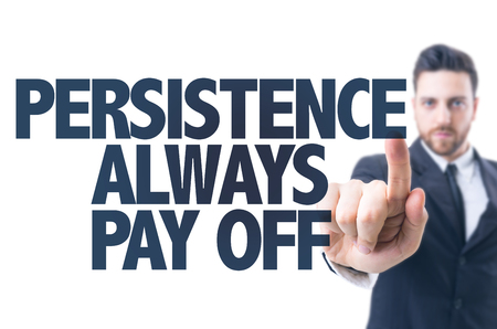 intrinsic: Business man pointing the text Persistence Always Pay Off