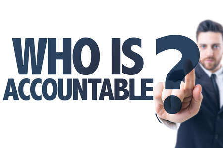 justify: Business man pointing the text Who Is Accountable? Stock Photo