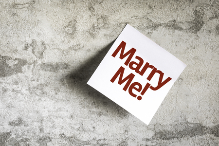 marry: Marry Me! written on paper note on texture background