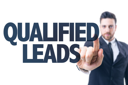 qualify: Business man pointing the text Qualified Leads Stock Photo