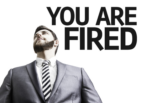unhappy man: Business man with the text You Are Fired in a concept image Stock Photo