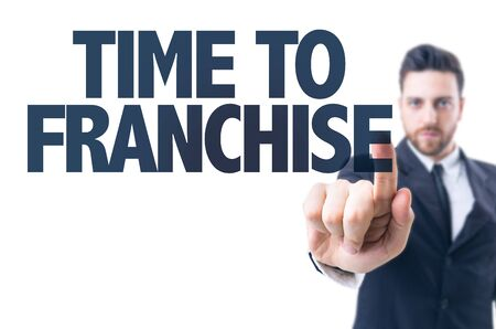 authorizing: Business man pointing the text Time to Franchise