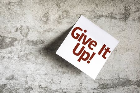 fortitude: Give It Up written on paper note on texture background Stock Photo