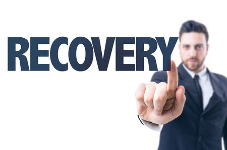 recovery: Business man pointing the text Recovery Stock Photo