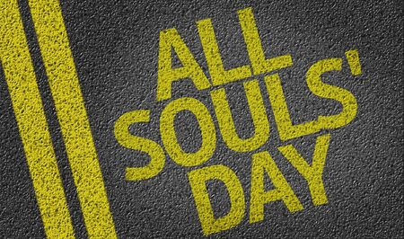 all souls' day: All Souls Day written on the road Stock Photo