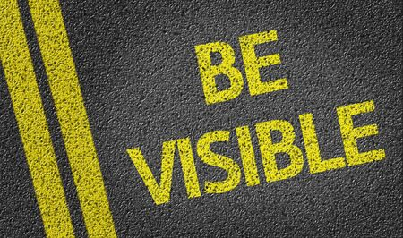 visible: Be Visible written on the road