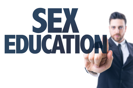 sex education: Business man pointing the text: Sex Education Stock Photo