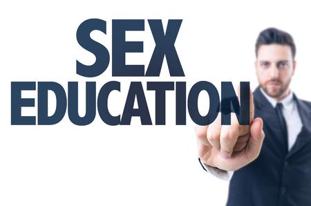hombre de negocios que señala el texto: Educación sexual Foto de archivo